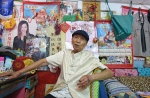 This photo taken on August 19, 2015 shows 93-year-old artist Huang Yung-fu posing at his home in the Rainbow Village in the Nantun district of Taiwan's central Taichung. (©AFP PHOTO / Sam Yeh)