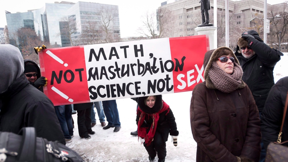 Demonstrators protest against Ontario's new sex education curriculum in Toronto on Tuesday, February 24, 2015. This year, Quebec will roll out a new pilot project in which sex education, like French and mathematics, will soon become mandatory for all students from kindergarten to the last year of high school, but approval of the plan is far from unanimous. THE CANADIAN PRESS/Darren Calabrese