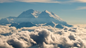 Mount McKinley pierces through the clouds above Denali National Park and Preserve in Alaska, on Aug. 3, 2015. (Andy Newman / Holland America Line)