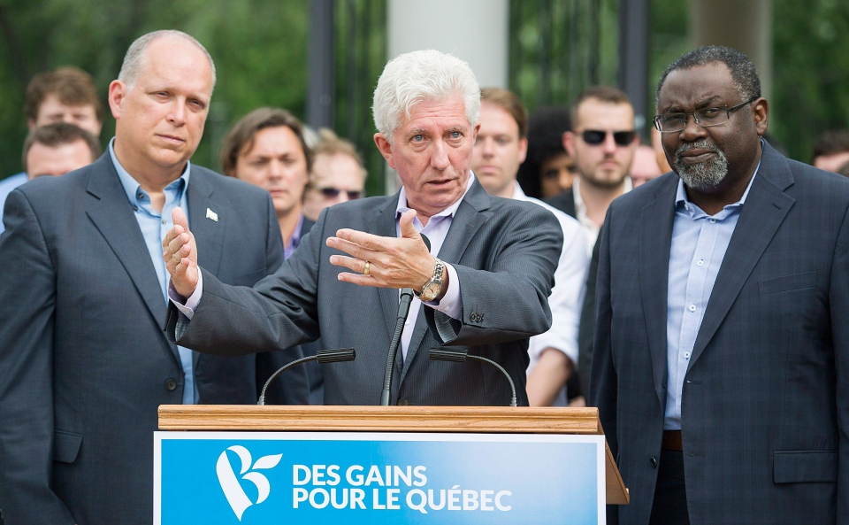 Bloc Quebecois leader Gilles Duceppe, centre, alongside MNA's Stephane Bergeron and Maka Kotto, right, speaks to supporters during a federal election campaign stop in Montreal, Monday, August 31, 2015. (Graham Hughes / THE CANADIAN PRESS)