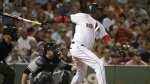 Boston Red Sox designated hitter David Ortiz, right, follows through on his swing as he hits a home run while New York Yankees catcher Brian McCann, left, looks on in the fourth inning of a baseball game at Fenway Park, in Boston on Aug. 31, 2015. (AP / Steven Senne)