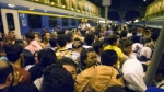 Migrants wait to board a train to Germany at the Keleti Railway Station in Budapest, Hungary on Sept. 1, 2015. (Zoltan Balogh / MTI)