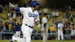 Los Angeles Dodgers' Adrian Gonzalez celebrates after scoring the game winning run on a single against the San Francisco Giants during the 14th inning of a baseball game in Los Angeles on Sept. 1, 2015. (AP / Chris Carlson)