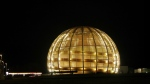 The globe of the European Organization for Nuclear Research, CERN, is illuminated outside Geneva, Switzerland on March 30, 2010. (AP / Anja Niedringhaus)