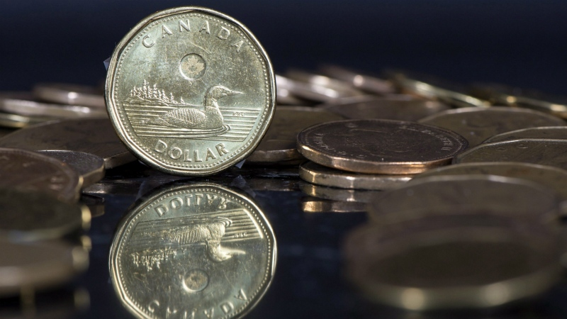 The Canadian dollar coin, the Loonie, is displayed in Montreal on Jan. 30, 2015. (Paul Chiasson / THE CANADIAN PRESS)