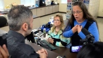 Rowan County Clerk Kim Davis, right, talks with David Moore in Morehead, Ky., Tuesday, Sept. 1, 2015. Although her appeal to the U.S. Supreme Court was denied, Davis still refuses to issue marriage licenses. (AP Photo/Timothy D. Easley)