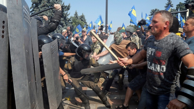 Ukrainian protesters clash with police after a vote to give greater powers to the east, outside the Parliament, Kyiv, Ukraine, Monday, Aug. 31, 2015. (AP / Efrem Lukatsky)