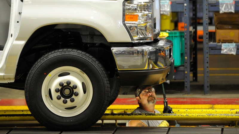 In this Aug. 12, 2015 photo, a worker works on the production line at Ford Motor Company's Ohio Assembly Plant in Avon Lake, Ohio. (AP / David Richard)