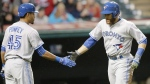 Toronto Blue Jays' Russell Martin, right, is congratulated by Dalton Pompey after scoring on a two-RBI double by Kevin Pillar in the fifth inning of a baseball game against the Cleveland Indians in Cleveland, Thursday, April 30, 2015. (AP / Tony Dejak)