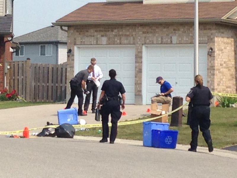 Police collect evidence in the area where gunshots were heard in a north London, Ont. neighbourhood on Tuesday, Sept. 1, 2015.  (Colleen MacDonald / CTV London)