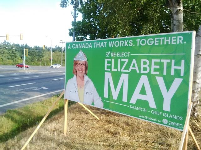 A campaign sign promoting Green Party Leader Elizabeth May's campaign for MP in the B.C. riding of Saanich-Gulf Islands was defaced with a tin foil hat, one of several similar incidents in the region since the campaign got underway. Sept. 1, 2015. (CTV Vancouver Island)
