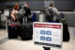 In this June 13, 2011 file photo, a fee sign is seen at Philadelphia International Airport in Philadelphia. (AP / Matt Rourke)