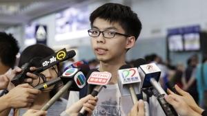 Hong Kong student leader Joshua Wong speaks to the media after arriving the Hong Kong airport on May 26, 2015. (AP / Kin Cheung)