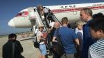 Passengers board an Air Koryo plane at the Pyongyang International Airport, in Pyongyang, North Korea on June 27, 2015. (AP / Wong Maye-E)