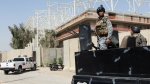 Iraqi security forces guard the entrance to a sports complex being built by a Turkish construction company, in the Shiite district of Sadr City, Baghdad, Iraq on Sept. 2, 2015. (AP / Khalid Mohammed)