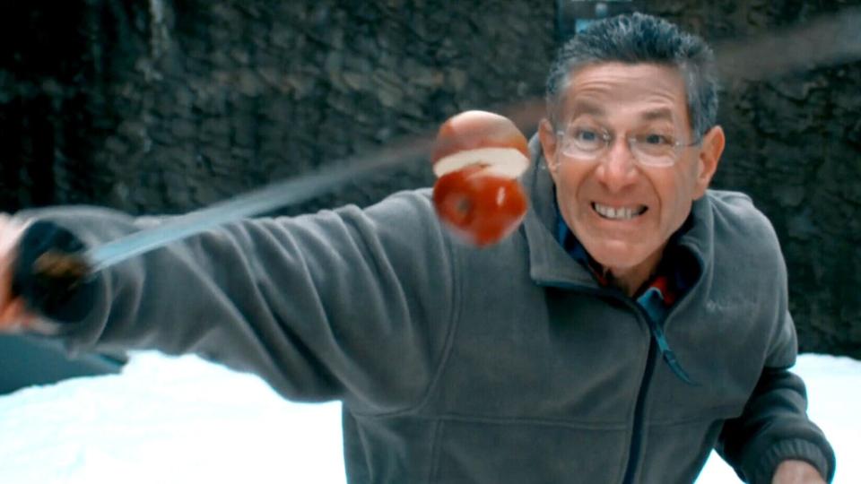 Ashrita Furman slices apples with a samurai sword in an attempt to break a Guinness World Record (Brian McGinn / Vimeo.com/brimcg)
