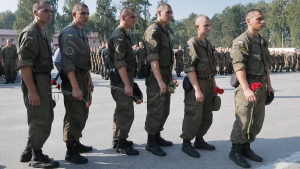 Ukrainian soldiers wait in line to pay tribute to National Guard soldier Igor Derbin at a military base in Novi Petrivtsi outside Kyiv, Ukraine, Wednesday, Sept. 2, 2015. (AP / Efrem Lukatsky)