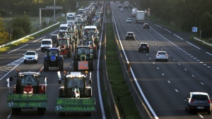 Farmers drive their tractors on the highway north of the French capital and leading to Paris on Sept.3, 2015. (AP / Thibault Camus)