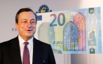In this Tuesday, Feb. 24, 2015, file photo, Mario Draghi, president of the European Central Bank, stands next to a facsimile of the new 20 euro banknote in Frankfurt, Germany. (AP/Michael Probst, File)