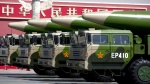 Military vehicles carrying DF-26 ballistic missiles, drive past Tiananmen Gate during a military parade to commemorate the 70th anniversary of the end of World War II, in Beijing Thursday, Sept. 3, 2015. (AP / Andy Wong)