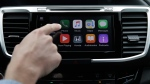 Chris Martin from Honda North America demonstrates Apple CarPlay in Torrance, Calif., on Aug. 20, 2015. (Jae C. Hong / AP)