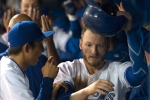 Toronto Blue Jays' Josh Donaldson, right, is congratulated by Munenori Kawasaki after scoring on a sacrifice fly from Blue Jays' Troy Tulowitzki during second inning AL baseball action against Cleveland Indians in Toronto on Wednesday September 2 , 2015. (Chris Young/THE CANADIAN PRESS)