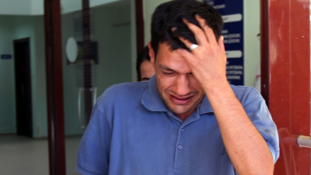 Abdullah Kurdi, 40, father of Alan and Galip, cries as he waits for the delivery of their bodies outside a morgue in Mugla, Turkey, on Thursday, Sept. 3, 2015. (AP / Mehmet Can Meral)
