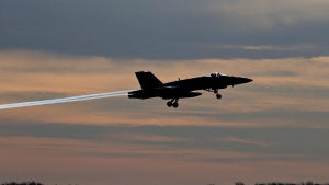 A CF-18 Hornet leaves for Kuwait from Cold Lake, Alta., on Tuesday, Oct. 21, 2014. (THE CANADIAN PRESS/Jason Franson)