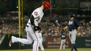 Washington Nationals' Bryce Harper, left, jogs to first base after being walked by Atlanta Braves relief pitcher Andrew McKirahan in the third inning of a baseball game at Nationals Park in Washington on Sept. 3, 2015. (AP / Pablo Martinez Monsivais)