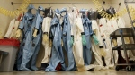Biohazard suits hang in a Biosafety Level 4 laboratory at the U.S. Army Medical Research Institute of Infectious Diseases at Fort Detrick, Md. on Aug. 10, 2011. (AP / Patrick Semansky)