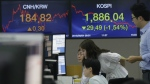 Currency traders watch monitors at the foreign exchange dealing room of the KEB Hana Bank headquarters in Seoul, South Korea on Sept. 4, 2015. (AP / Ahn Young-joon)