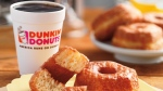 This product image provided by Dunkin' Donuts shows a coffee and donut. (AP / Dunkin Donuts)