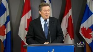Toronto Mayor John Tory speaking at a press conference for Lifeline Syria saying he will personally open his doors to a refugee family.