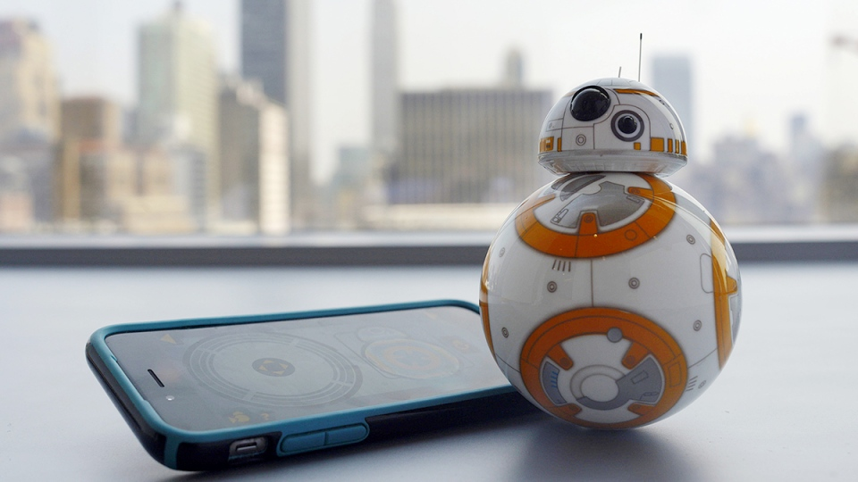 Sphero's BB-8 droid toy is controlled with a smartphone or tablet app and responds to basic voice commands such as 'wake up,' and 'look around.' It's just under five-inches tall and makes sounds reminiscent of R2-D2. (AP / Patrick Sison)