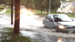 MyNews: Cars drive through flooded street