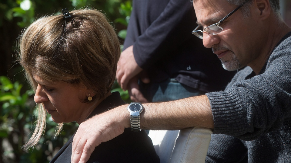 Tima Kurdi, left, aunt of late brothers Alan and Ghalib Kurdi, is comforted by her husband Rocco Logozzo as she speaks to the media outside her home in Coquitlam, B.C., Friday, Sept. 4, 2015. (Darryl Dyck / THE CANADIAN PRESS)