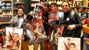 Fans pose with their new Star Wars: The Force Awakens merchandise on Force Friday at Disney Store, Stockton Street in San Francisco, on Friday, Sept. 4, 2015. (Photo by George Nikitin/Invision for Disney Consumer Products/AP Images)