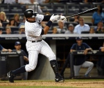 New York Yankees designated hitter Alex Rodriguez hits a two-run home run off of Tampa Bay Rays starting pitcher Jake Odorizzi in the second inning of a baseball game at Yankee Stadium on Friday, Sept. 4, 2015, in New York. (AP /Kathy Kmonicek)