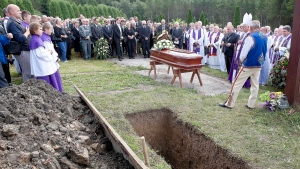 Mourners gather for the burial of Jozef Wesolowski, a former archbishop accused of abusing teenage boys, in Czorsztyn, Poland, on Saturday, Sept. 5, 2015. (AP)
