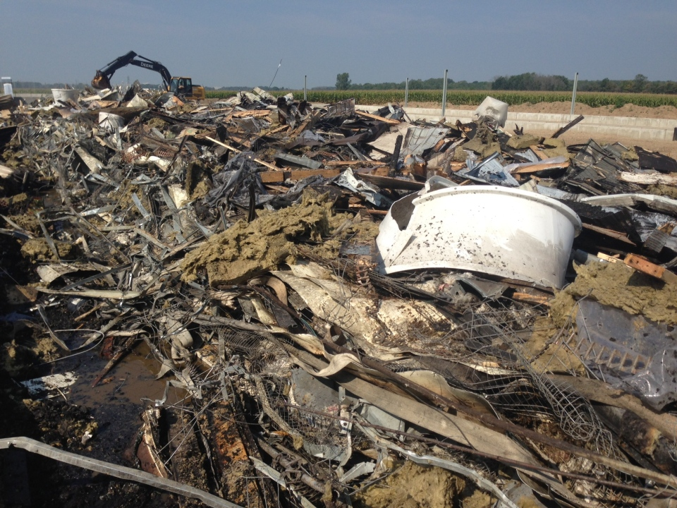 Debris from a barn fire on a poultry farm is shown on Monday September 7, 2015.