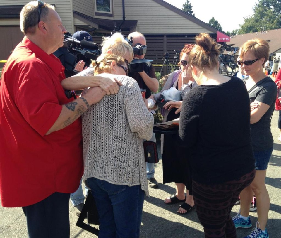 An emotional moment at the Pitt Meadows fire scene. Cherished family photos recovered from a damaged suite. (CTV)