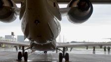 FILE - A CRJ-900 sits on a runway in Minneapolis, Minn., on Wednesday, June 6, 2007. (AP Photo/Jim Mone)