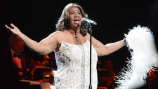 Aretha Franklin sings in Bridgeport Conn., on Friday, March 20, 2015. (AP Photo/The Hour, Alex von Kleydorff)