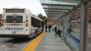 Passengers board an iXpress bus at the Ainslie Street terminal in Cambridge on Tuesday, Sept. 8, 2015. (Kevin Doerr / CTV Kitchener)