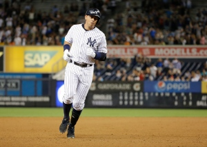 New York Yankees' Alex Rodriguez runs the bases after hitting a home run during the sixth inning of a baseball game against the Baltimore Orioles on Tuesday, Sept. 8, 2015, in New York. (Frank Franklin II/AP Photo)