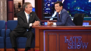 "Stephen Colbert, right, talks with Republican presidential candidate Jeb Bush during the premiere episode of ""The Late Show,"" in New York on Sept. 8, 2015. Bush and actor George Clooney were the guests for Colbert's debut. (Jeffrey R. Staab / CBS)"