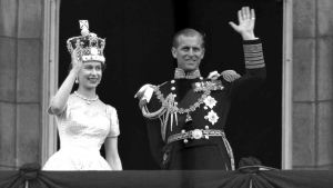 Queen Elizabeth II and Prince Philip, Duke of Edinburgh, as they wave to supporters from the balcony at Buckingham Palace, following her coronation at Westminster Abbey. London, June. 2, 1953. (AP / Leslie Priest)