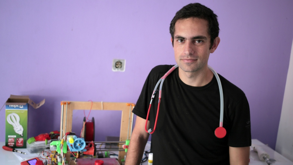 Dr. Tarek Loubani, a Palestinian-Canadian doctor, poses for a picture with 3D printed stethoscope around his neck, in Gaza City on Sept. 7, 2015. (AP / Khalil Hamra)