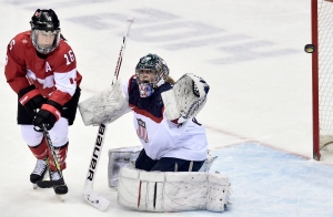 Canada's Jayna Hefford (left) watches the puck sail wide past USA goalie Jessie Vetter during second period women's hockey final action at the 2014 Sochi Winter Olympics in Sochi, Russia in this file photo from Thursday, Feb. 20, 2014. (Nathan Denette/THE CANADIAN PRESS)