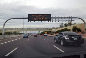 A freeway sign asked for information about a shooting that shattered a rear window of a white truck on I-10 between 43rd Ave. and 35th Ave. in Phoenix, on Wednesday, Sept. 9, 2015. (AP / Traci Carl)